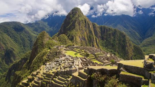 view of Machu Picchu from nearby mountain